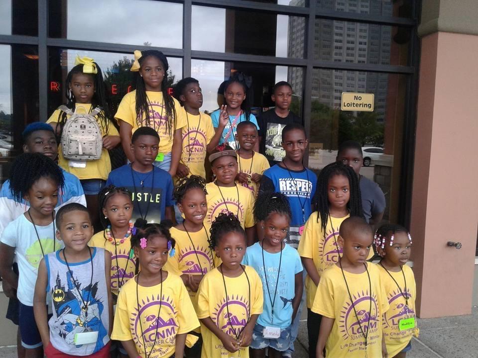 Serving at kids camp